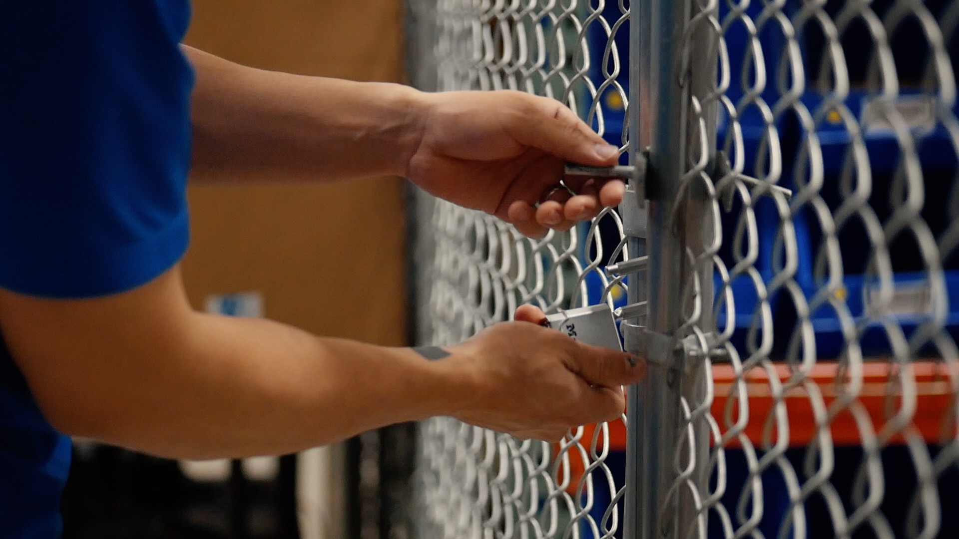 WDSrx employee securing lock at one of pharmaceutical logistic facilities