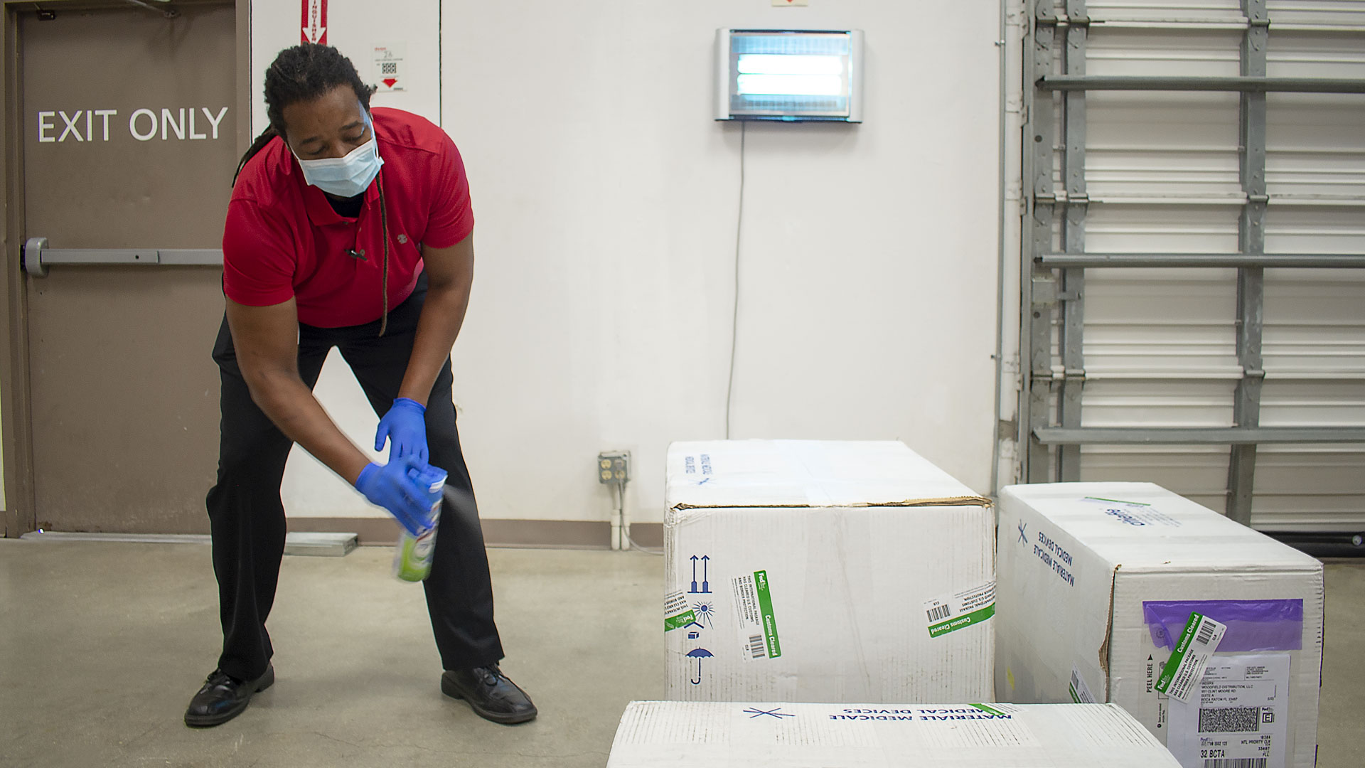 news highlights involving Oliver Razz sanitizes a shipment in the quarantine area at the pharmaceutical logistics warehouse