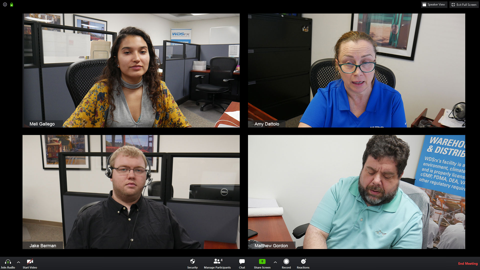 To maintain business continuity, employees work together over video calls in the office