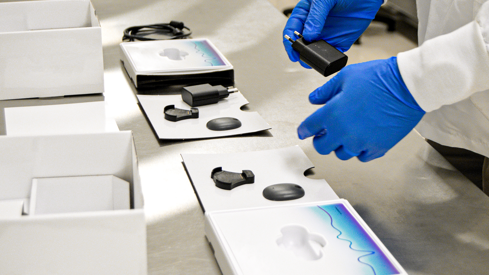 Medical devices being kitted for packaging.