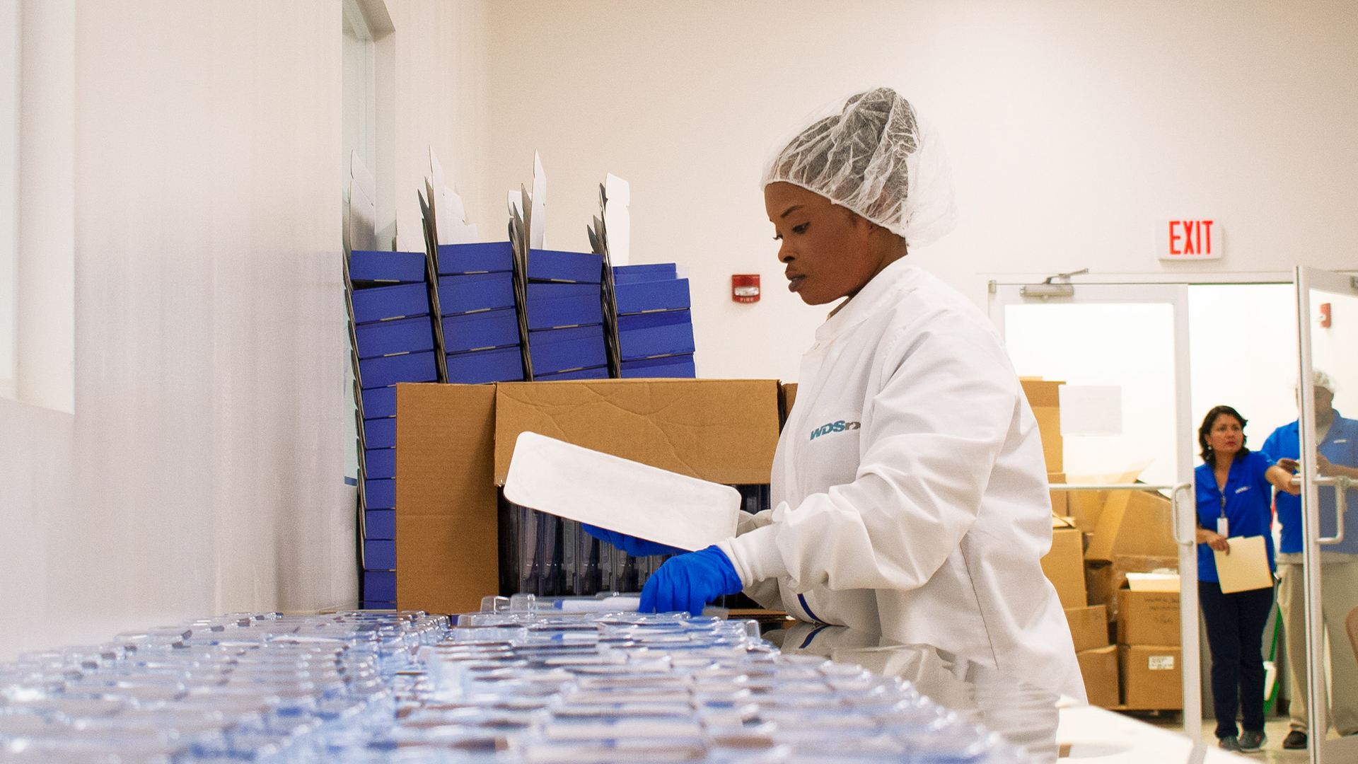 WDSrx Production Technician begins packaging a medical device kit.