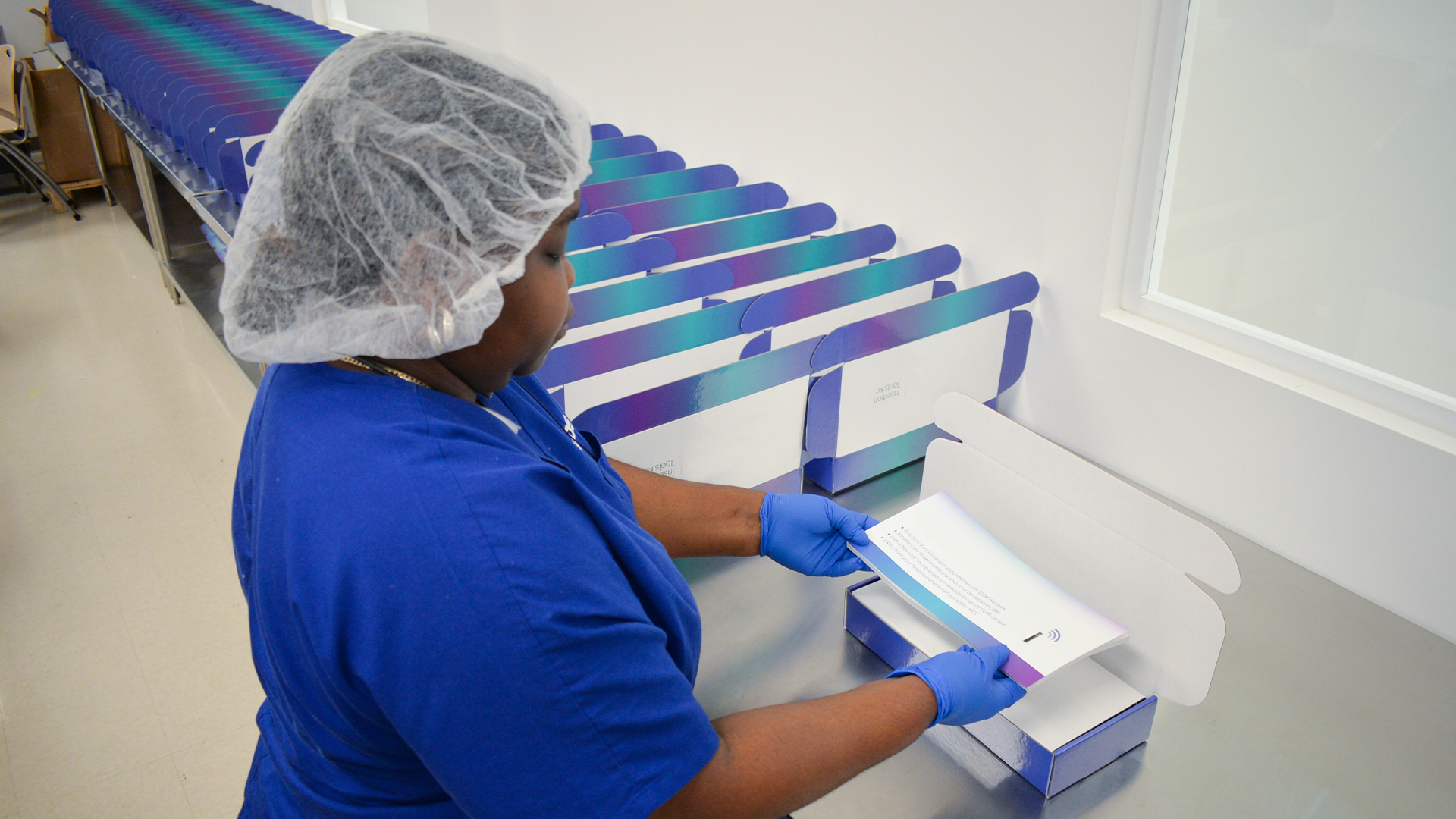WDSrx Production Technician assembles last medical device box from line.