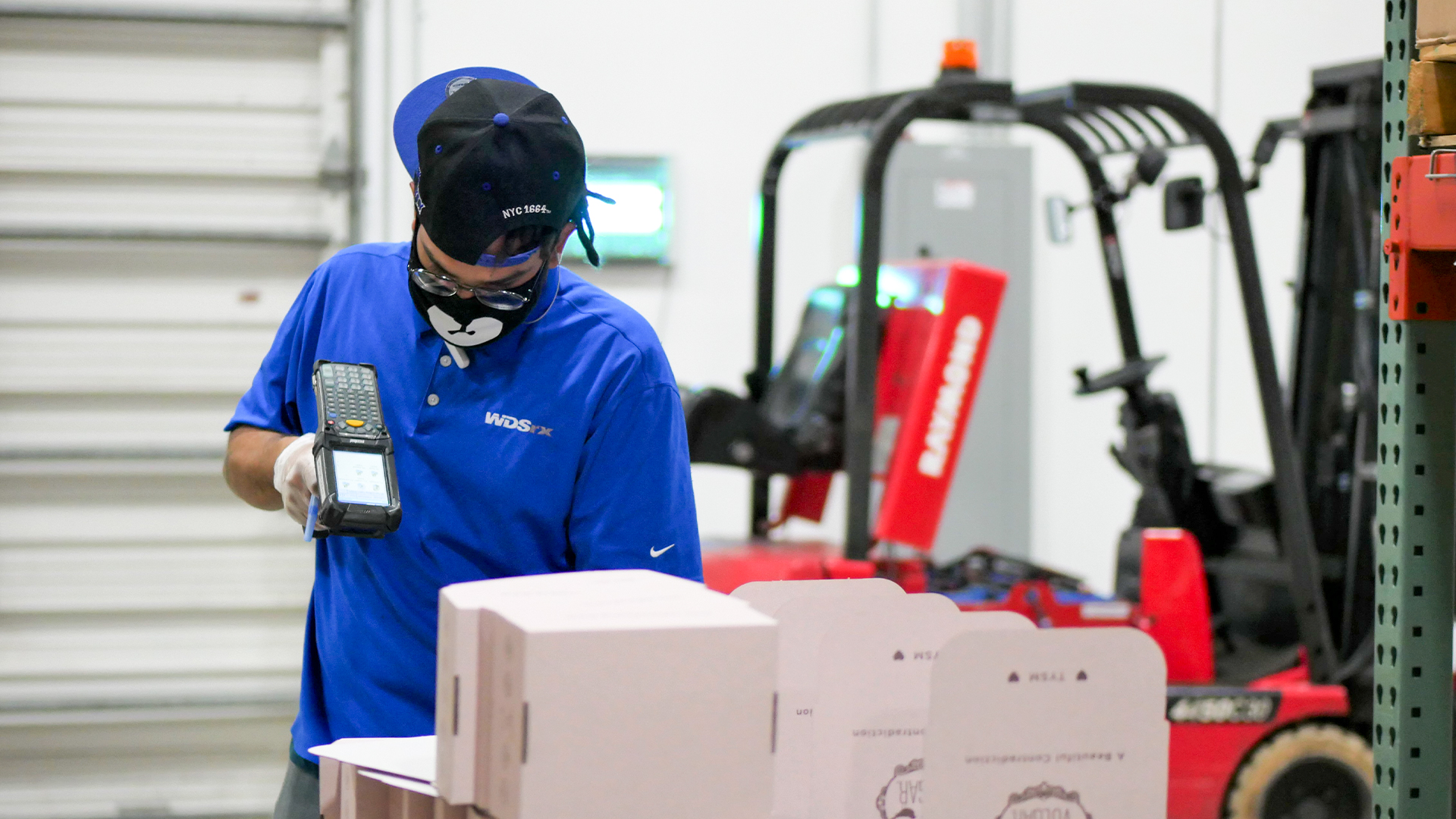 WDSrx Warehouse Technician picks an order for a cosmetics client.