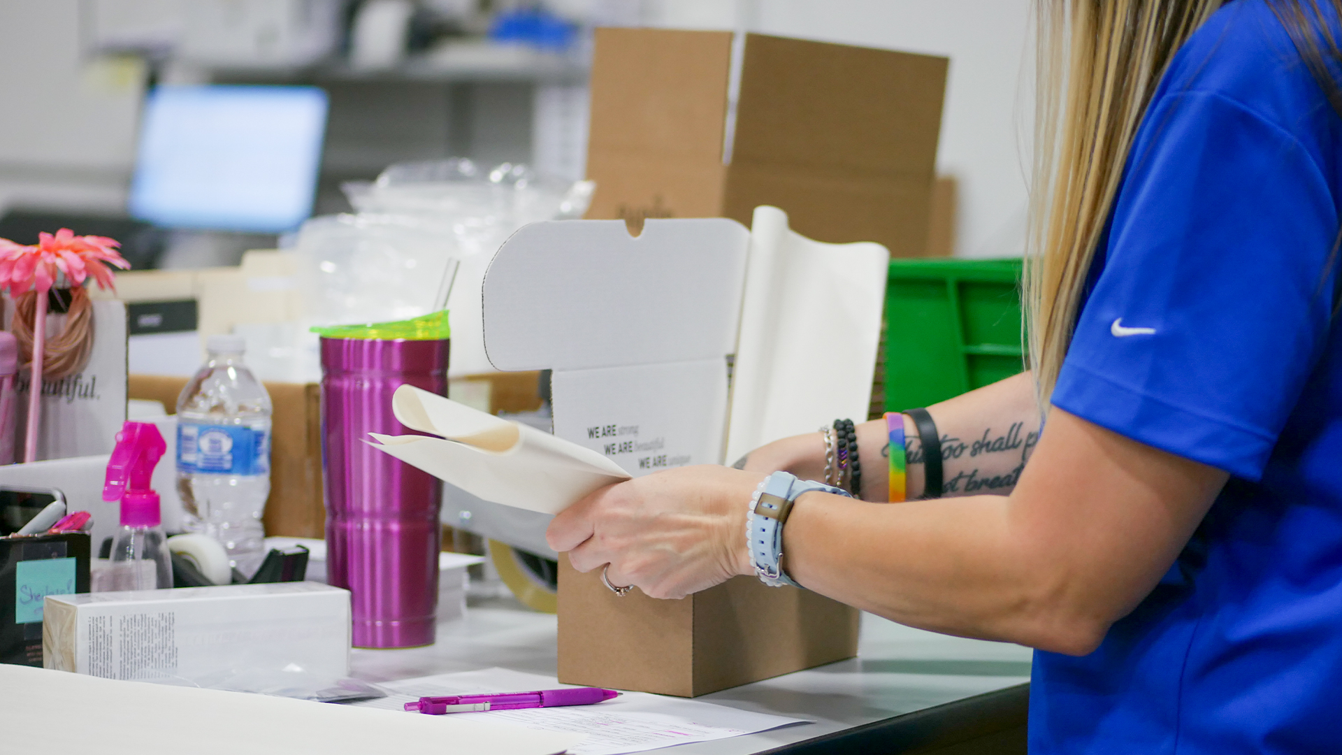 WDSrx Warehouse Technician packages an e-commerce order for a cosmetics client.