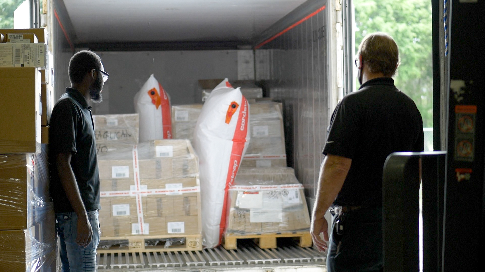 Two Warehouse Managers receive inbound order.