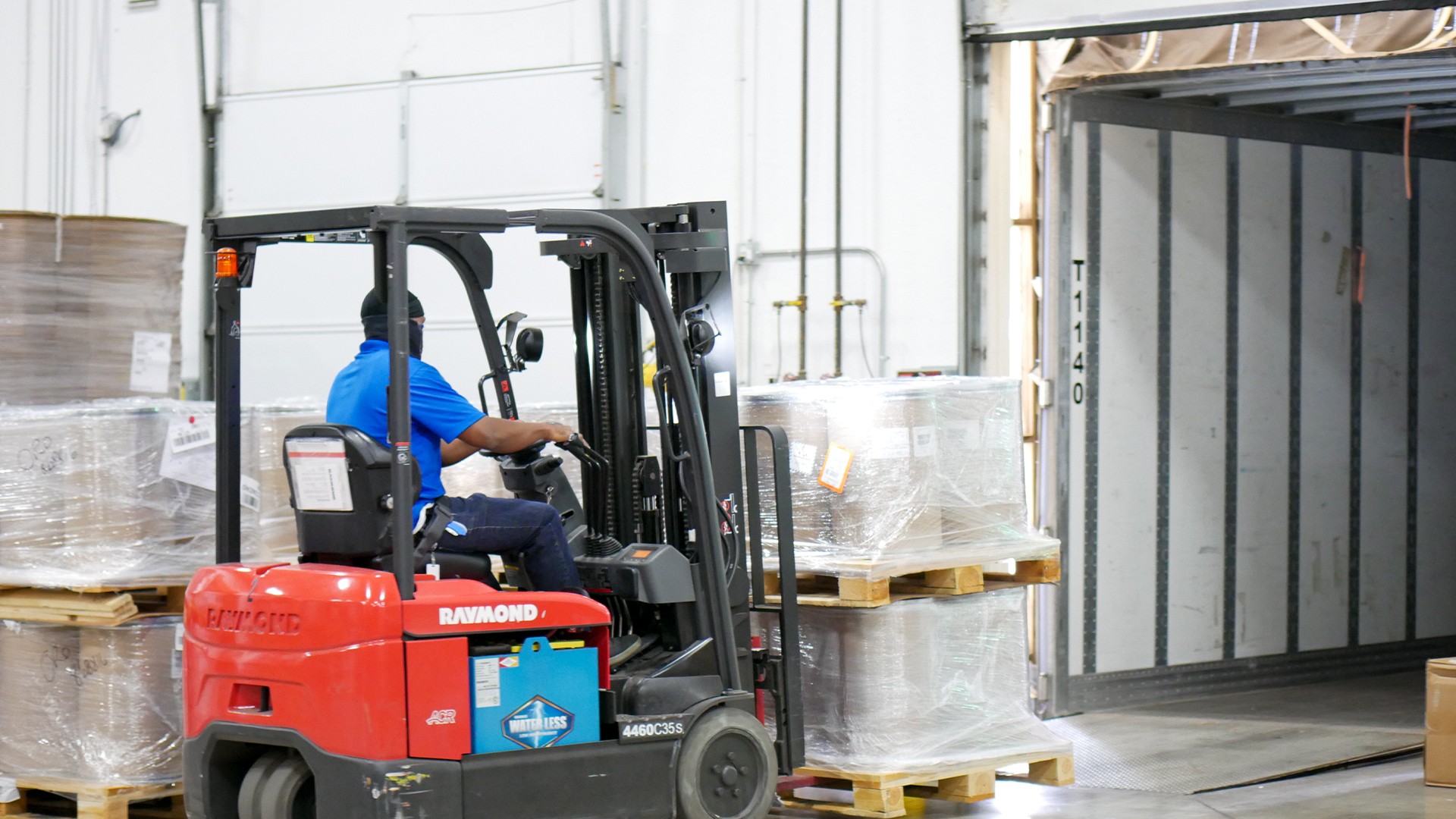 warehouse technician loading API materials to truck using forklift