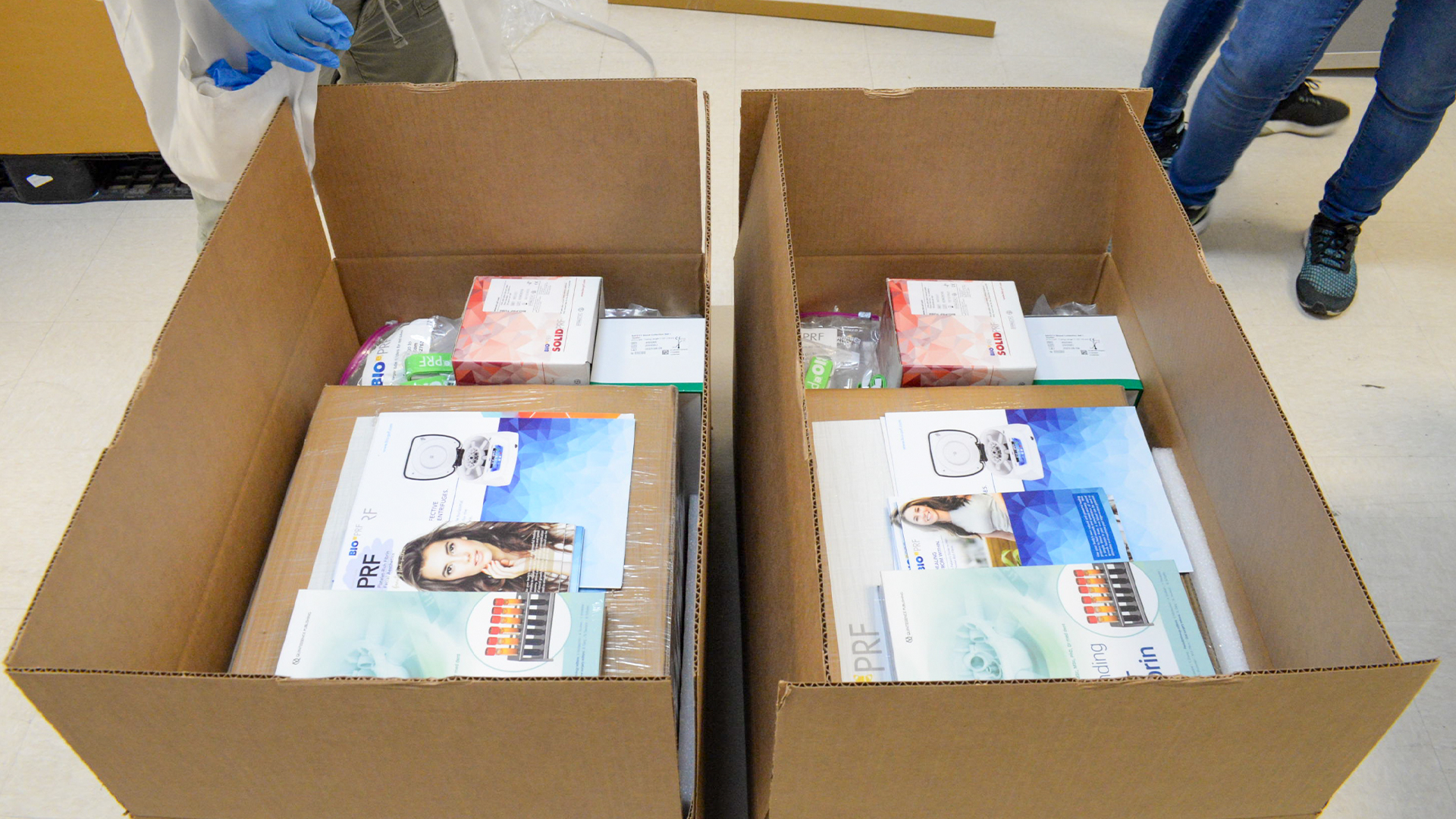 two boxes with medical devices and promotional materials